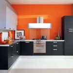 modern kitchen interior design with black gray cabinetry and orange wall paint and wonderful clock wall target and white flooring