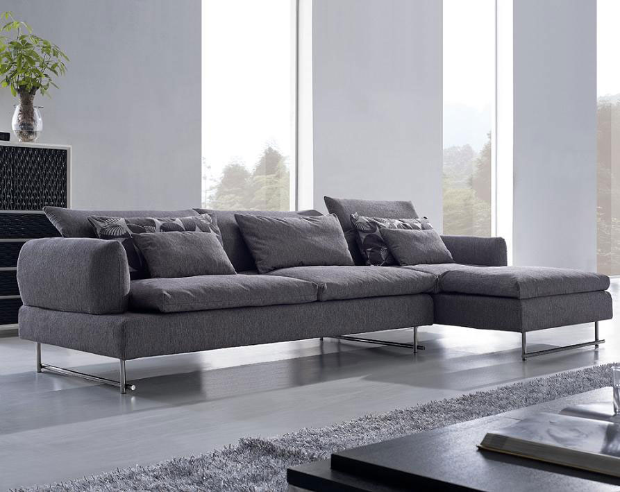 Long Sectional Sofa Design for Luxurious Interior Look  : modern living room design with gray long sectional sofa design with furry area rug and black coffee table and dresser from homesfeed.com size 893 x 709 jpeg 88kB