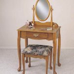 natural wooden small vanity idea with patterned black stool with wooden frame and round mirror