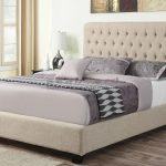 Oatmeal Ivory Tall Upholstered Bed Feauring Pretty Tufted Headboard And Grey Bedlinen Plus Dark Wooden Floor And Stylish Table Lamp