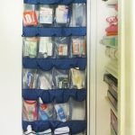 Over The Door Shoe Holder From Plastic With Dark Blue Color Use For Storing And Organizing The First Aid Kit Hang On White Door And Should Be Within Easy Reach