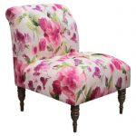 playful floral patterned pink accent chair idea with carved wooden legs and armless
