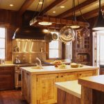 rustic kitchen ideas with brown kitchen cabinets and pot rack with lights together with wooden wall and floor plus stainless steel appliance
