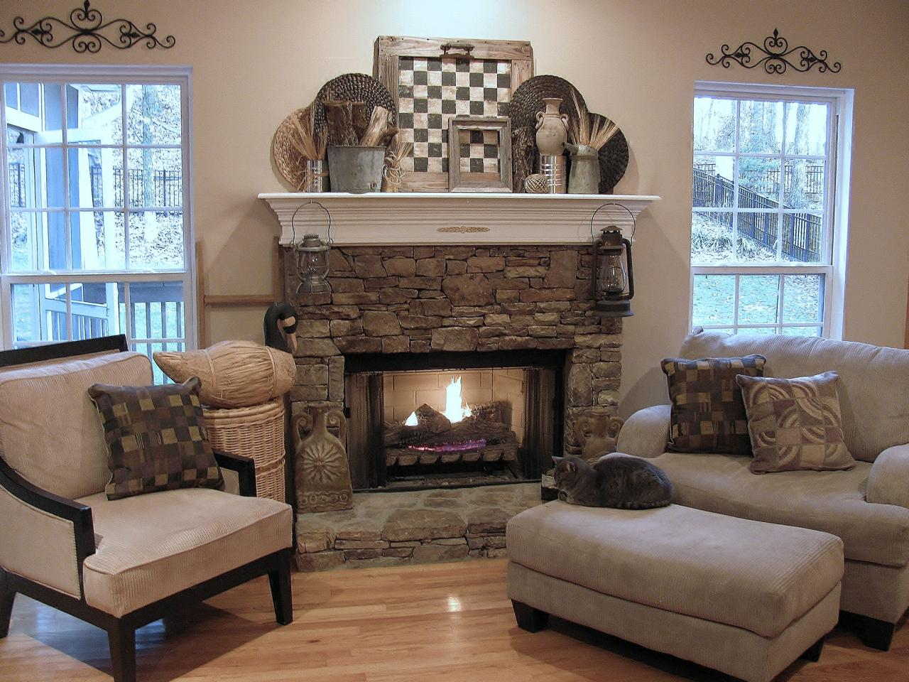 Rustic Mantel Decor Made Of Stone Decorated With Cozy Armchairs Plus Comfy Single Couch Completed