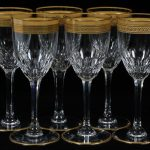 set-of-six-T.Louis-SLT27-wine-glasses-with-gold-rimmed-and-pattern-SLT27-with-claret-wine-glasses-feature-clear-crystal-with-panels-and-gold-laurel-band-also-trim