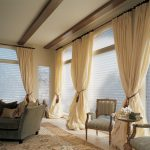silhouette wide window treatments with extra long drapes featuring blind decorated on the windows of family room together with dark upholstered sofa