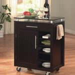 simple black wooden kitchen cart idea with wheel and storage and glass top