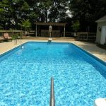 simple long and rectangle best house swimming pool design with concrete patio design