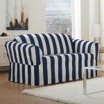 Striped Navy And White Love Seat Slip Covers With Soft Rug And Glass Top Coffee Table Featuring White Shade Table Lamp