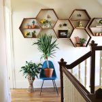 Stunning And Creative Diy Wall Shelves Idea In The Shape Of Honeycomb With Blue Chair And Indoor Plants And Wooden Floor And Stairs Railing