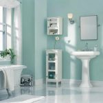stunning blue bathroom color trend idea with whit5e freestanding sink and storage and floating vanity