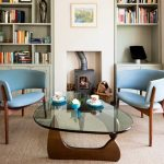 stunning blue chairs in scandinavian interior design with triangle coffee table and wooden floor and bookshelves