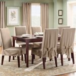 stunning creamy  slip cover for dining room chairs design with wooden legs and wooden dining table and centerpiece