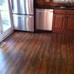 stunning dark brown finish hardwood floor vs laminate installed in the awesome kitchen decor