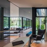 stunning home with minimalist and erginomic style with black leather reclining chair and wooden laminated flooring