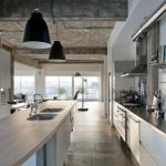 stunning industrial loft kitchen design idea with open plan and white cabinetry and tile flooring and black pendant