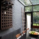 stunning interior design with stone siding idea and skylight and glass window and black wooden table with wine rack