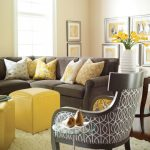 stunning living room design with brown sofa with sectional and yellow couch and arm chair and furry area rug