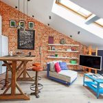 stunning loft design interior with skylight and glass window and white sofa bed with blue coffee table with wooden kitchen bar with orange stools