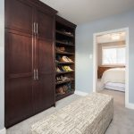 stunning master bedroom design with large and classic wooden closet idea and bench and white modern bedding