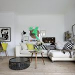 stunning scandinavian interior decor with white luxurious sofa with wooden floor and yellow accent and green tone