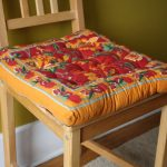 stunning yellow dining room seat design cushion with cherry pattern on wooden chair