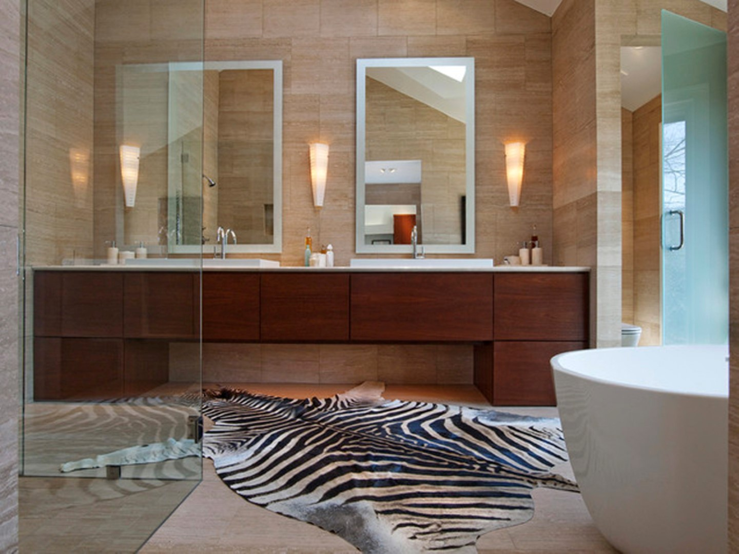 stylish zebrahid bathroom contemporary rug design with wooden vanity and framed wall mirror and white bathtub and beige wooden wall