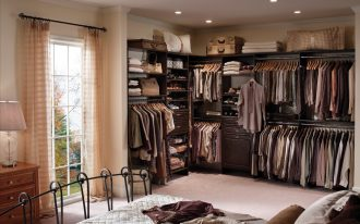 super crowded master bedroom design with walk in closet in modern style with storage bin and black iron bedding frame