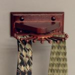 The Carousel Wall Mounted Tie Rack With Dark Cherry Finishing Touch And Handcrafted From Nothern Birch Hardwood For Ties And Necklaces