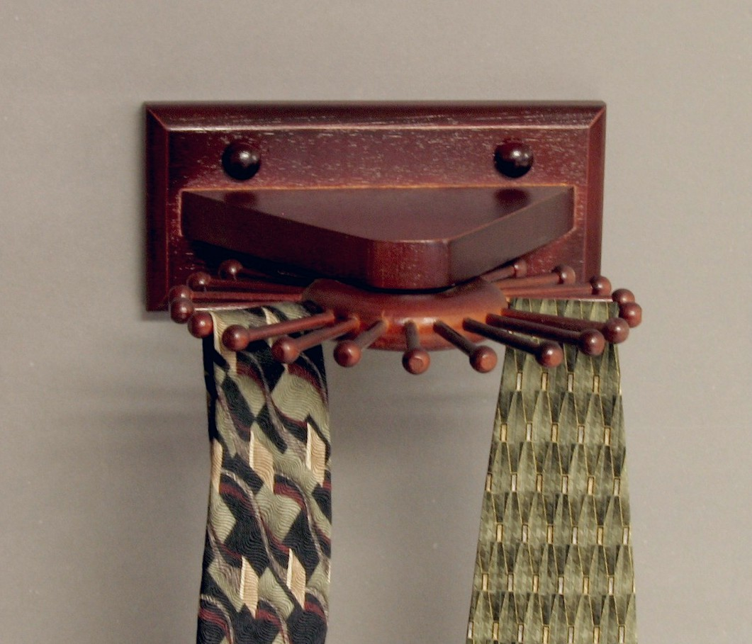The Carousel Wall Mounted Tie Rack With Dark