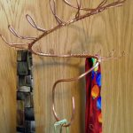 the-spiral-tie-rack-with-wall-curly-hook-and-long-hook-spiral-for-organize-and-display-ties-in-easily-accessible-way-also-mounted-on-the-wall-or-inside-a-closet-door(1)
