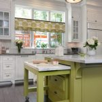 traditional-kitchen-in-white-and-green-wtih-calacatta-marble-top-and-features-roll-out-kneading-table-for-space-saving-with-large-12-foot-island-topped