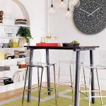 uniqe interior design with black wooden table and steel scandinavian stools with round wall decoration and lighting track and unique recessed arched shelves