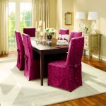 unique and luxurious purple  slip cover for dining room chairs design and wooden dining table with white area rug and wooden floor