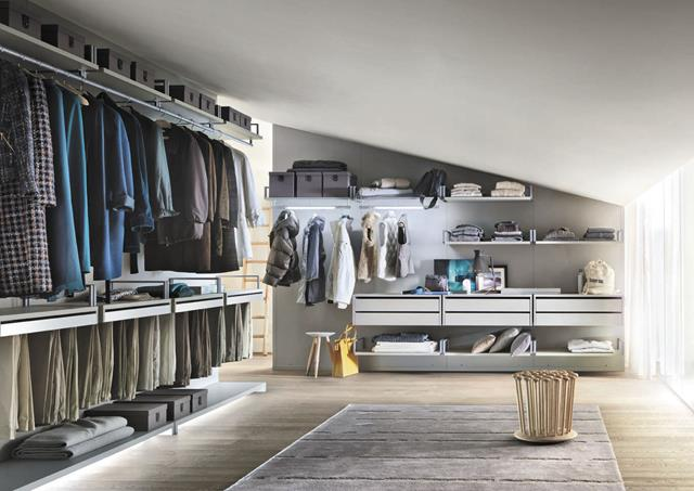 unique and luxurious walk in wardrobe design in the loft with wall storage and gray area rug and glass window