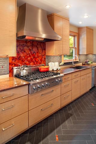 unique chevron tile floor design in gray color with tan cabinetry idea with red flashing backsplash and glass window