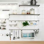 unique kitchen design with stainless steel floating shelf on white small tile backsplash