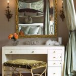 unique minimalist and bohemian combination of dressing table with root framed wall mirror and bench in evening hue and lantern on the wall