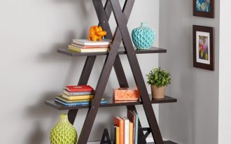 unique woodne crossed freestanding bookshelves design with potted plant and colorful books on wooden floor