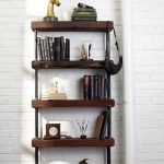 vintage and rustic freestading bookshelves design with iron black frame beneath white brick wall