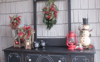 vintage-outdoor-christmas-decoration-by-attagirlsays-with-park-hill-lanterns-and-red-berries-with-chalkboard-mugs-on-the-black-vintage-buffet