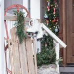 Vintage Outdoor Christmas Decoration Near Front Door With Decorative And Photogenic White Vintage Ice Skate Hang On The Vintage Slade