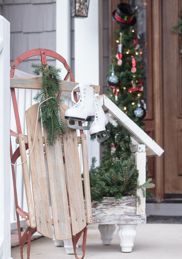 vintage outdoor christmas decoration near front door with