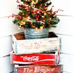 Vintage Outdoor Christmas Decoration With Some Vintage Soda Crates Place In The Corner On The Outside With Handmade Little Christmas Tree