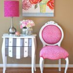 vintage pink accent chair design with round backrest and adorable stripe end table and pink shaded table lamp and wooden floor