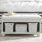 white coated wooden end bed bench with white cushion and shelf for books and box storage units