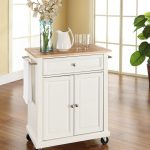 white kitchen cart with wheels design with beige top and vas flower and table ware