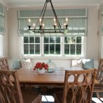 wide window treatments with turquoise shade in dining room with awesome candlelier featuring stunning wooden dining chairs