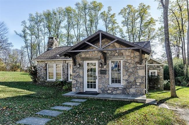 Superb retreat with rustic stone application in the for Stone and glass house designs