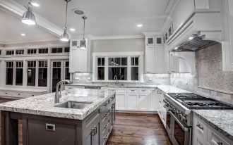 wonderful kashmir white granite countertops for contemporary kitchen ideas together with metal pendant lamps and wooden floor